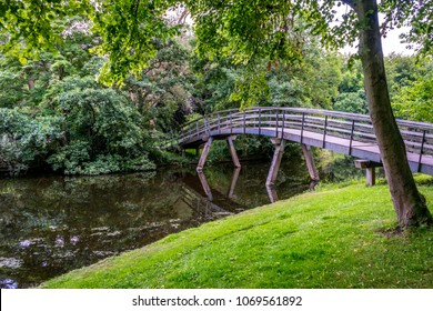 Bridge over a lake at Haagse Bos, forest in The Hague, Netherlands, Europe