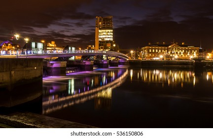 Bridge over the most important River (river Lagan) in Belfast in Northern Ireland. Photo taken during nighttime.