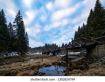 Bridge over a mountain river in winter landscape