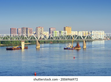 """The bridge over the Ob River on the background of the new residential area """"Yasny Bereg"""". Siberia, Russia - Shutterstock ID 2006966972"""