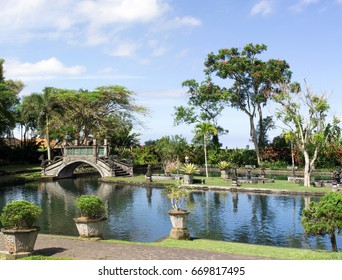 The bridge over the pond in the park of Tirta Gangga Temple, Bali Island, Indonesia
