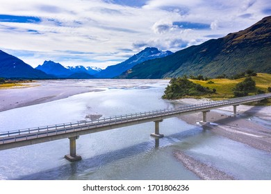 Bridge over the river bank in Glenorchy, scenic Routeburn track popular tourist destination in   Fiordland National Park with a view of Mount Alfred National Park in Glenorchy, Otago, New Zealand