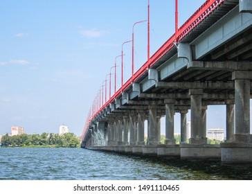 bridge over the river, city embankment (pedestrian, automobile or railway bridges) landscape. beautiful nature, sky