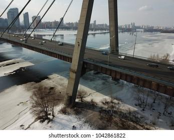 Bridge over river in a city. Traffic