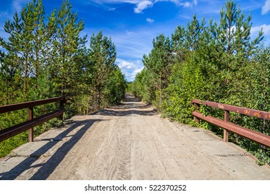 The bridge over the river in the forest. Middle Urals.