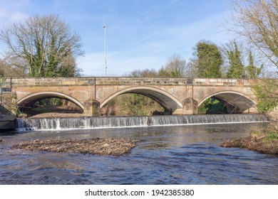 Bridge over the River Goyt, and Otterspool Weir, at Stockport Hydro community hydroelectric plant, Stockport, Cheshire UK.