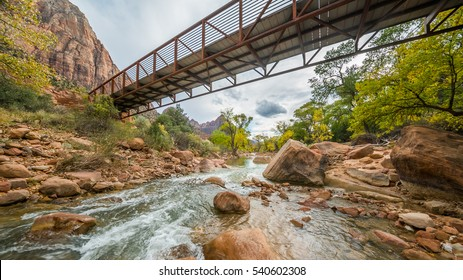 Bridge over the river. Large stones among water flow. The Virgin River flowing through Zion National Park, Utah, USA
