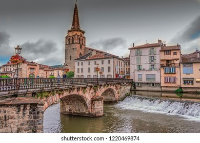 Bridge over the river Salat and church in the center of the village of Saint Girons. Ariege France