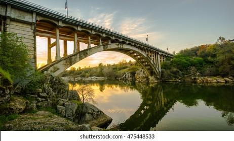 Bridge over River at Sunset in Folsom, California