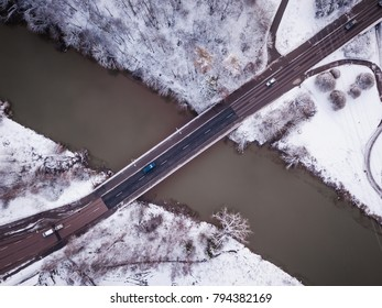 Bridge over river Vantaa in winter with some traffic and snow