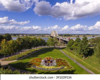 Bridge over the river Waal in Nijmegen, Holland with park and coat of arms of the city in flowers