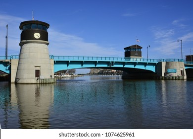 The bridge over the Root River in Racine Wisconsin in early evening on a sunny spring day.