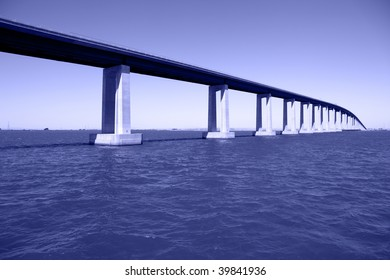 Bridge over San Joaquin River Delta at Antioch California, high enough at apex to allow seagoing cargo vessels to pass beneath.