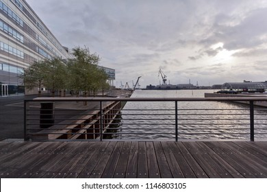 Bridge over the sea channel at dusk and view of the industrial port in Århus. Denmark.