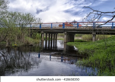 bridge over a small river and the car on it