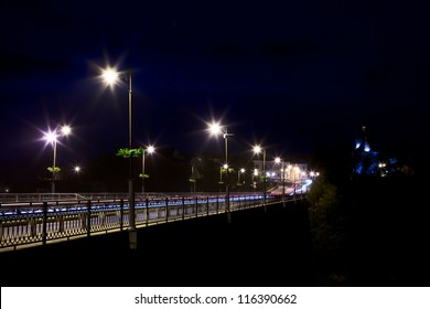 bridge over Smotrych River in Kamianets-Podilskyi, Ukraine, at night