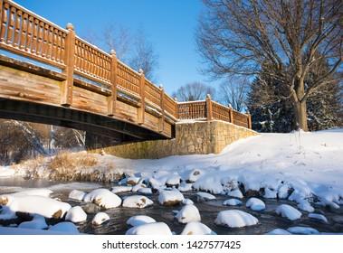 Bridge over snowy creek In Northwest Ohio