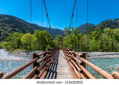 Bridge over stream in kamikochi, Japan