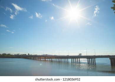 Bridge over water with bright sunflare