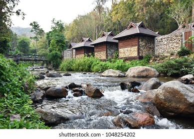 Bridge over water fall and huts