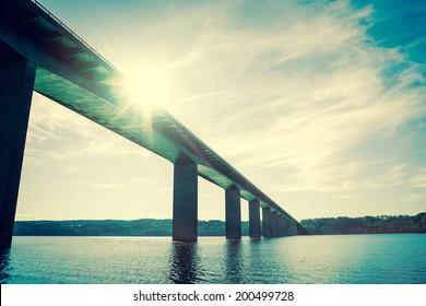 Bridge over water with sunshine