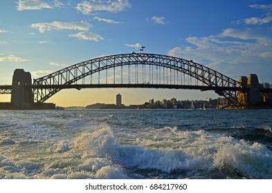 Bridge over waves at sunset