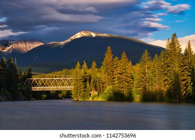 Bridge over a wild river in Canada. Beautiful sunset in the mountains. perfect scenery with wonderful light.