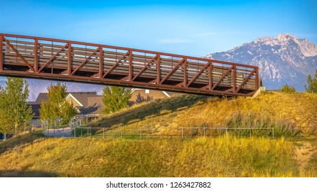 Bridge over a winding path in Scenic Daybreak Utah