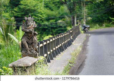 The bridge over Yeh Unda River alongside Raya Muncan Road, protected by a hindu godess scultpture. Photo taken in Desa Muncan, Bali, Indonesia.