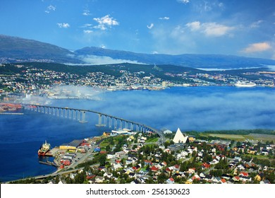 Bridge and panorama of city Tromso, Norway beyond the Arctic circle. View on mountains in Norwegian fjords