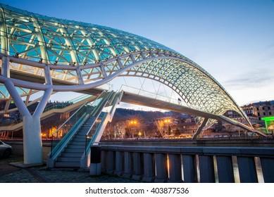 The Bridge of Peace over the Kura River in Tbilisi during twilight