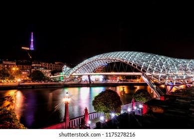 Bridge of Peace reflected in Kura River in Tblisi, Georgia