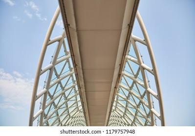 The bridge of Peace in Tbilisi over the river Kura. Part of the iron bridge. Close up
