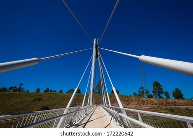 Bridge Pedestrian Cables Blue Pedestrian cable strung suspended public bridge over highway on a blue sky day