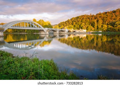 Bridge in Piestany (Slovakia), dark sky + colorful autumn