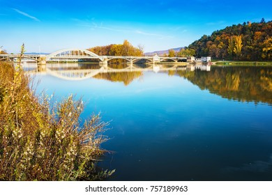 Bridge in Piestany (Slovakia), Vah river,  blue sky, colorful autumn