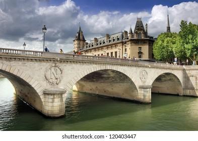 The bridge Pont au Change over river Seine in Paris, France.