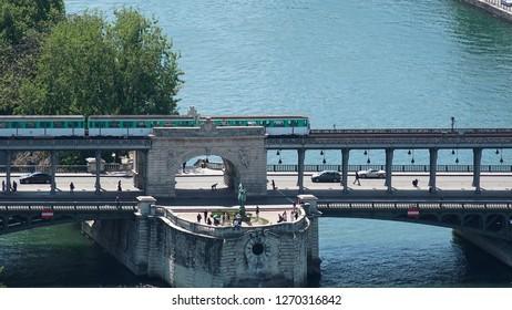 Bridge Pont de Bir- Hakeim and a tourist boat on Seine river
