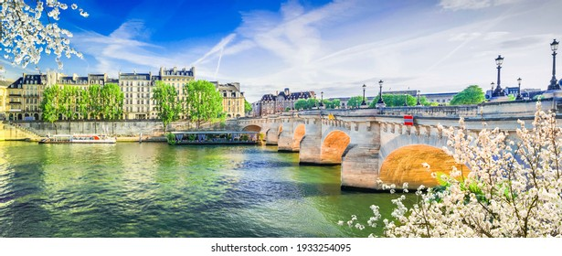 bridge Pont Neuf and Seine river with old houses of Cite island, Paris streets at spring, France, wide panorama with sunshine