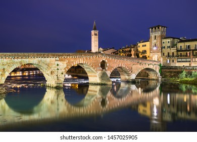 Bridge Ponte Pietra in Verona, Italy at night