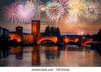 Bridge Ponte Scaligero with fireworks on the black sky in Verona, Veneto region, Italy