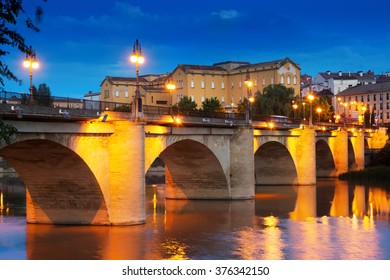 bridge (Puente da Piedra) over Ebro river in night. Logrono, Spain