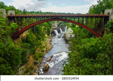 Bridge and Rainbow Falls at Ausable Chasm in Upstate New York. The gorge is about two miles 3.2 km long and is a tourist attraction in the Adirondacks region of Upstate New York