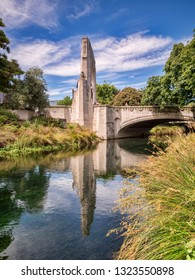 The Bridge of Remembrance and Cashel Street Bridge in the centre of Christchurch, New Zealand, reflected in the River Avon.