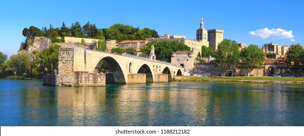 The bridge Saint-Benezet on the Rhone in front of the palace of the popes in Avignon in Provence, France.