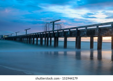Bridge to the sea with sunset behind, in east of Thailand