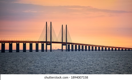 The Öresund Bridge seen from Malmö a summer evening during sunset.