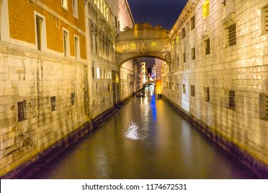 Bridge of Sighs Night Colorful Small Canal Buildings Reflections Venice Italy.  Bridge between Doge's Palace and Prison