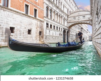 Bridge of sighs. Traditional Venetian transport. Gondola floating along the canal in Venice. Italy