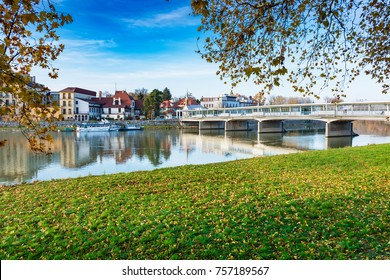 Bridge to spa island in Piestany, Vah river, riverbank, blue sky (Slovakia)